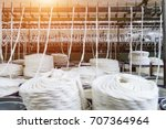 rolls of industrial cotton... | Shutterstock . vector #707364964