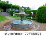 small fountain in the middle of ... | Shutterstock . vector #707450878