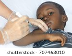 sad african boy is worried... | Shutterstock . vector #707463010