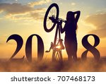 girl with bicycle at sunset.... | Shutterstock . vector #707468173