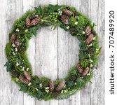 winter wreath with mistletoe ...   Shutterstock . vector #707489920