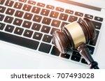 wooden gavel on laptop keyboard.... | Shutterstock . vector #707493028