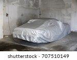 car covered under silver sheet... | Shutterstock . vector #707510149