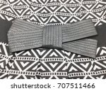black cloth bow on fragment of... | Shutterstock . vector #707511466