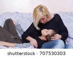 mother looking with affection... | Shutterstock . vector #707530303