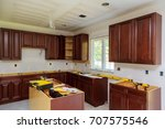 Stock photo installing new induction hob in modern kitchen installation of kitchen cabinet 707575546