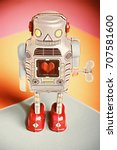 Small photo of Vintage Toy Tin Windup Robot with heart symbol in center