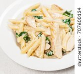 Small photo of Chicken Alfredo Spinach Parmesan Pasta. Selective focus.