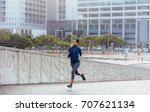 woman runner in jogging outfit... | Shutterstock . vector #707621134