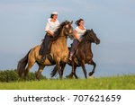Two Women Ride Andalusian...