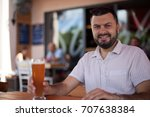 happy man holding beer and... | Shutterstock . vector #707638384