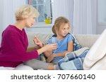mom giving medicines to her... | Shutterstock . vector #707660140