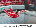 Small photo of WARSAW, POLAND, AUGUST 5, 2017: Young woman flying in an aerodynamic tunnel.