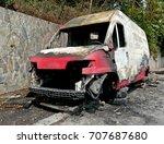 burnt red van on the road