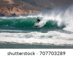 surfer catches a wave with good ...   Shutterstock . vector #707703289