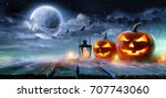 jack o  lanterns glowing at... | Shutterstock . vector #707743060