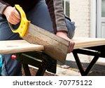 sawing a wooden plank | Shutterstock . vector #70775122