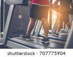gym shot   people walking on... | Shutterstock . vector #707775904