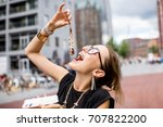 young woman eating herring with ... | Shutterstock . vector #707822200
