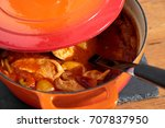 Small photo of Chicken paprika casserole in a ceramic dish with a ladle