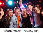 young people having fun a party. | Shutterstock . vector #707859484
