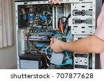 young woman repairing computer | Shutterstock . vector #707877628