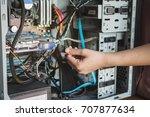 young woman repairing computer | Shutterstock . vector #707877634