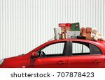 Santa's Red Car With Gift Boxes ...