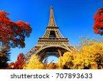 eiffel tower in autumn park... | Shutterstock . vector #707893633