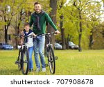 dad and son standing with their ... | Shutterstock . vector #707908678