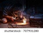 worker with protective welding... | Shutterstock . vector #707931280