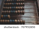 old wooden abacus laying on the ... | Shutterstock . vector #707952850