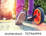 feet on the scooter. the girl... | Shutterstock . vector #707964994