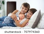 two children  toddler and his... | Shutterstock . vector #707974360