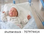 beautiful newborn baby boy ... | Shutterstock . vector #707974414