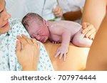 happy mom  having her baby skin ... | Shutterstock . vector #707974444