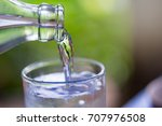 pouring water from a bottle... | Shutterstock . vector #707976508