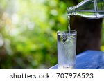 pouring water from a bottle... | Shutterstock . vector #707976523