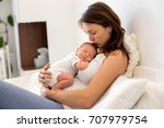 young mother lying in bed with... | Shutterstock . vector #707979754