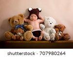 newborn baby boy wearing a... | Shutterstock . vector #707980264