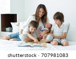 young mother  read a book to... | Shutterstock . vector #707981083