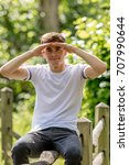 Teenage boy in a park on a warm summers day - stock photo