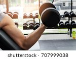 athlete man training in the gym.... | Shutterstock . vector #707999038