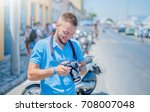 young photographer loves his... | Shutterstock . vector #708007048