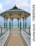 Small photo of Beautiful Bandstand by Brighton Beach, Victorian construction with grey skies in the background, Hove, England, UK