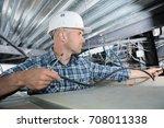 electrical worker wiring in... | Shutterstock . vector #708011338