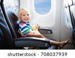 child in airplane. kid in air...   Shutterstock . vector #708037939