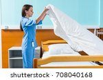 young nurse in blue unifrom... | Shutterstock . vector #708040168