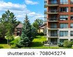 modern condo buildings in cote... | Shutterstock . vector #708045274