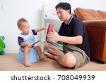 father training his son to use... | Shutterstock . vector #708049939